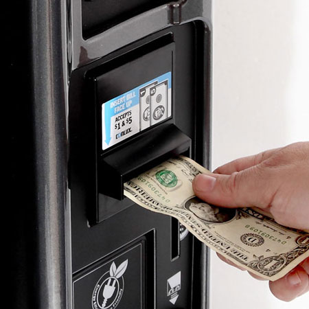 Bill and coin acceptor in vending machine